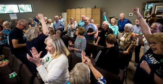 Iowa residents on vacation and supporters of Democratic Presidential candidate Amy Klobuchar react after she had the most members of support during an satellite Iowa Caucus at the Unitarian Universalist Fellowship of Charlotte County in Port Charlotte on Monday Feb 3, 2020. Iowa residents from all over Florida participated.