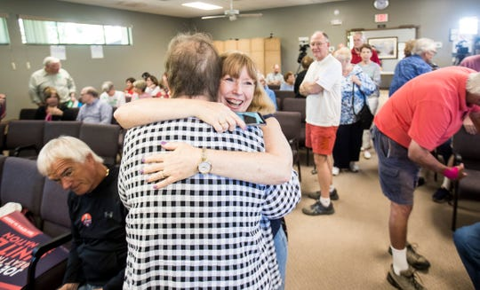 Iowa resident Karla Hansen and supporter of Democratic Presidential candidate Joe Biden hugs friend and fellow Iowa resident Kathie Farris during a satellite Iowa Caucus at the Unitarian Universalist Fellowship of Charlotte County in Port Charlotte on Monday Feb 3, 2020. Iowa residents on vacation from all over Florida participated. Hansen's family was supporting several candidates. Her husband supports Pete Buttigieg, her daughter supports Elizabeth Warren and her son supports Bernie Sanders.