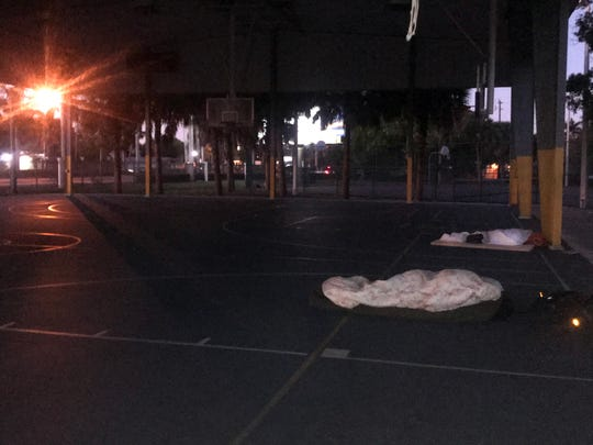 Two Lee County homeless people sleep in a mall parking lot in Tice on Jan. 21 during a night of frigid temperatures. The Lee County Homeless Coalition estimated there were fewer than 300 beds for around 3,000 homeless people in 2018. Many of the county's shelter beds require a person to meet certain conditions such as having an addiction or mental health problem or be willing to observe Christianity.
