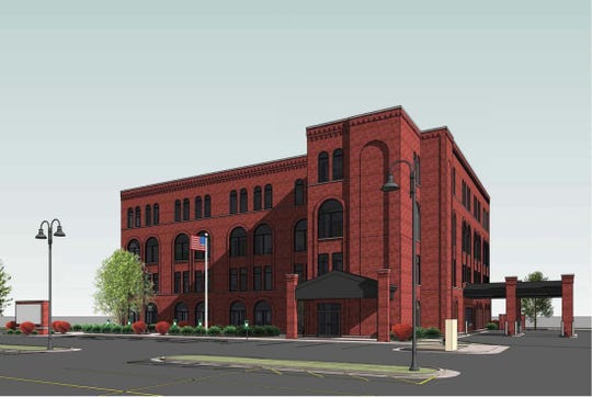 A rendering of a new office building Nifong Realty is proposing to build at 2181 S. Oneida St. This view looks toward South Oneida Street. The building would replace a one-story office building with a red-brick building designed to provide an older appearance with modern office amenities.