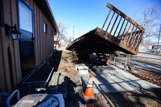 The deck at 3227 1st Ave. S. was ripped off its footings when the large pine tree at the residence was toppled in Saturday's windstorm.