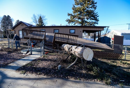 The deck at 3227 1st Avenue South was ripped from its footings when the large pine tree at the residence was toppled in Saturday's record breaking windstorm.