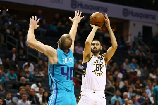 """Pacers center Goga Bitadze shoos a three-point basket against Charlotte Hornets forward Cody Zeller (40) during the first half at Spectrum Center on Jan. 6, 2020. Nate McMillan recently went through some tape with Bitadze and told him: """"You have shots you need to take."""