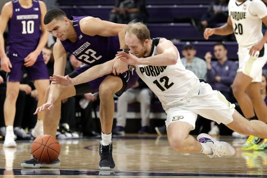 Northwestern forward Pete Nance, left, and Purdue forward Evan Boudreaux battle for the ball during the first half of an NCAA college basketball game in Evanston, Ill., Saturday, Feb. 1, 2020. (AP Photo/Nam Y. Huh)
