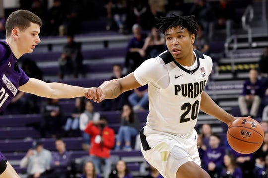 Purdue guard Nojel Eastern, right, drives against Northwestern forward Robbie Beran during the first half of an NCAA college basketball game in Evanston, Ill., Saturday, Feb. 1, 2020. (AP Photo/Nam Y. Huh)