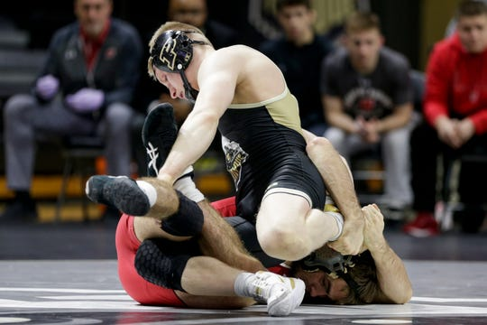 Purdue's Parker Filius wrestles Wisconsin's Tristan Moran during a 141 pound bout in a Big Ten Duals wrestling match, Sunday, Feb. 2, 2020 at Holloway Gymnasium in West Lafayette.