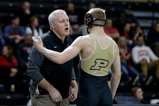 Purdue's Parker Filius talks with coach Tony Ersland during a 141 pound bout in a Big Ten Duals wrestling match, Sunday, Feb. 2, 2020 at Holloway Gymnasium in West Lafayette.