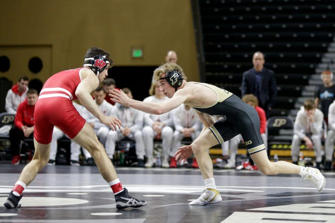 Purdue's Devin Schroder wrestles Wisconsin's Eric Barnett during a 125-pound bout on Sunday, Feb. 2, 2020 at Holloway Gymnasium. Schroder helped the Boilermakers knock off No. 21 Northwestern to open the 2021 season