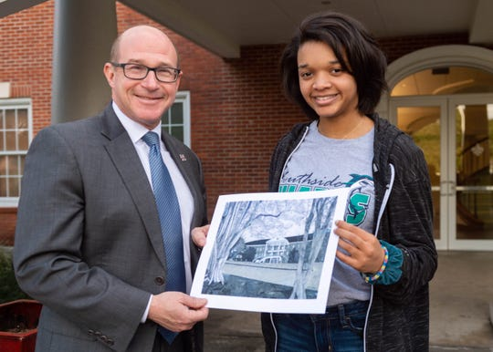 Southside High School art student Jasmine Anderson discusses her pen and ink drawing of Martin Hall at the University of Louisiana at Lafayette with Jaimie Hebert, UL provost and academic vice president Monday, Feb. 3, 2020.