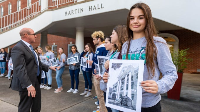 Southside High School art student Camryn Watson is among about 20 who donated their pen and ink drawings of University of Louisiana at Lafayette buildings to the university Monday, Feb. 3, 2020. Watson drew Doucet Hall.