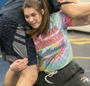 Eliana Bommarito of Hartland works out in the wrestling room of the high school Monday, Feb. 3, 2020 with fellow teammate Jacob Gizinski.