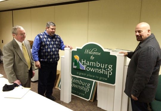 Hamburg Township Clerk Jim Neilson (left), Trustee Mike Dolan (center) and real estate agent Rick Beaudin (right) discuss the importance of identifying Hamburg Township as a community Jan. 19, 2016. Neilson passed away on Monday Feb. 3, 2020 after battling amyotrophic lateral sclerosis, or ALS. Neilson also served for several years as the township's clerk.