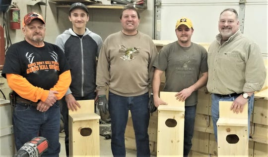 Maribel Sportsmen's Club and Francis Creek Sportsmen's Club members have wood duck and bluebird houses available again this spring. People helping build the first round of houses included, from left, Don Marquardt, Chase Marquardt, Tom Rauen, Mannon Marquardt and Karl Puestow.