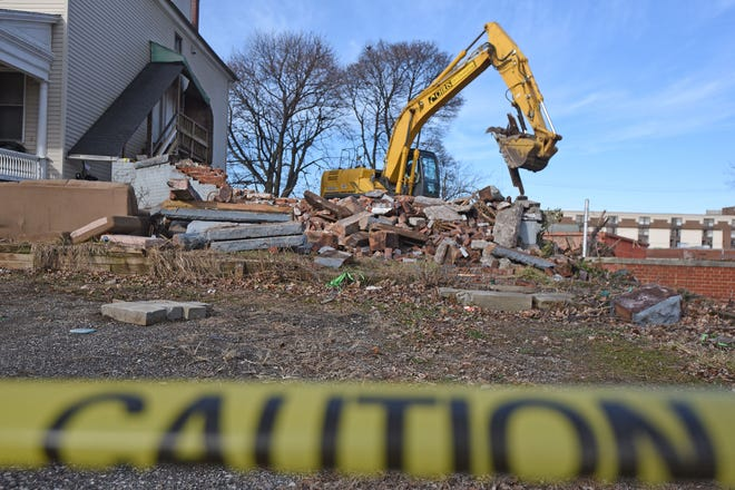 The house once occupied by Shawn Grate, at 132 West Second Street, was demolished Monday afternoon.