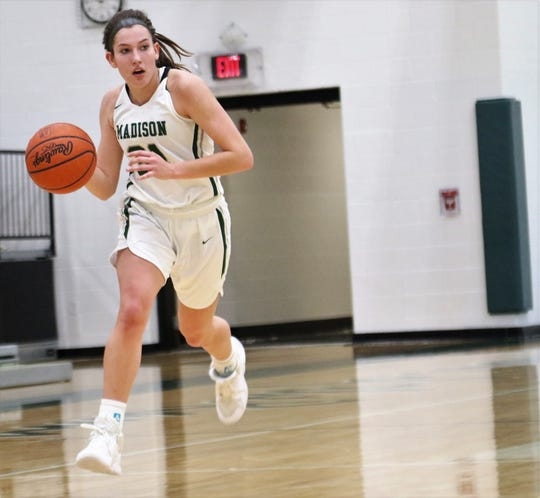 Madison's Chesney Davis drives to the basket during a loss to Lexington on Saturday.