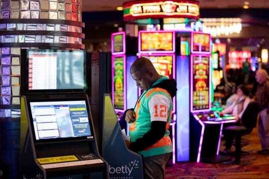 Chris Long, of Memphis, places bets on NBA and college basketball games Monday, Feb. 3, 2020, using a sports betting kiosk at Southland Casino Racing in West Memphis.