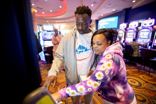 Pedro Grayer and Tasha Smith place bets on a sports betting kiosk Monday, Feb. 3, 2020, at Southland Casino Racing in West Memphis.