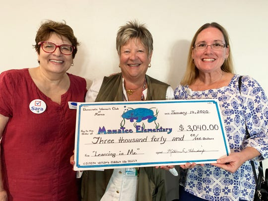 The Democratic Women's Club of Marco (DWCM) presented a check for $3,040 to School Counselor Deborah Eby and Principal Dr. Laurie Mearsheimer of the Manatee Elementary School at its January meeting. The DWCM formed a partnership with Manatee School where many of the students are the children of farm and low income workers. DWCM conducted a very successful silent auction and raffle which culminated in this contribution. Above: DWC Marco President Stephanie Ballo presents the check to Deborah Eby and Dr. Laurie Mearsheimer of Manatee Elementary School.