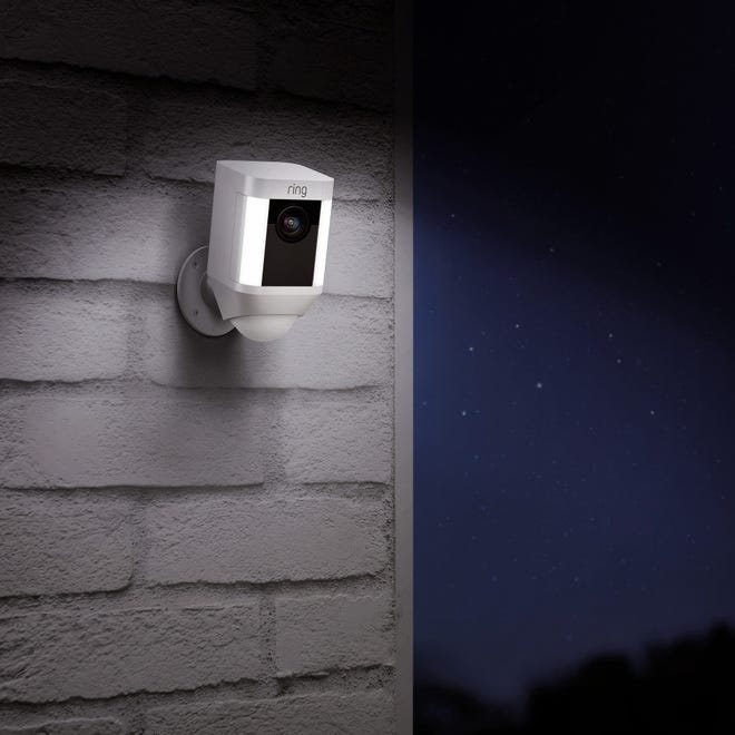 Illustration shows a Ring outdoor camera with lights.