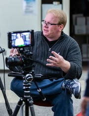 South Milwaukee High School alumnus and Emmy winning filmmaker Kyle Olson, interviews resident Dolores Page during a commercial shoot at the school on Saturday, Feb. 1, 2020.