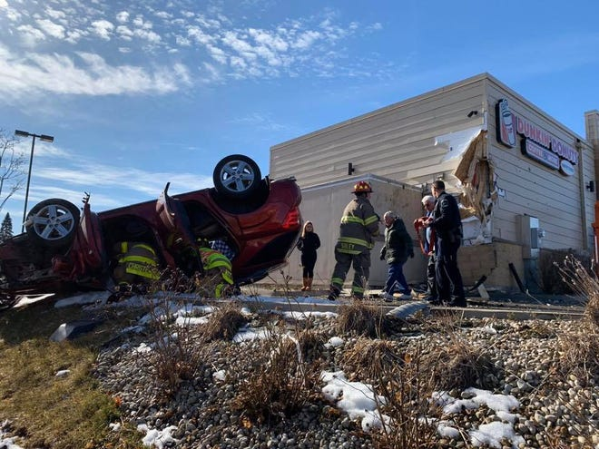 """A vehicle drove up a small hill and hit the South Milwaukee Dunkin Donuts, 3103 S. Chicago Ave., on Feb. 3. The driver was taken to the hospital for """"serious injuries"""" according to the South Milwaukee Fire Department."""
