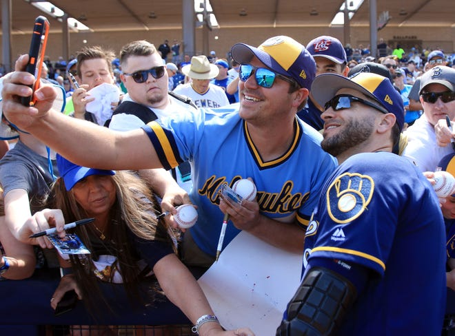 Ryan Braun poses with a fan before a Brewers' spring training game last March in Phoenix.