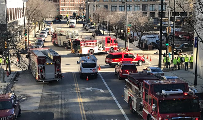 Emergency crews were evacuating buildings in a portion of downtown Milwaukee after a natural gas line was apparently ruptured into the area of 3rd Street between Wells and Wisconsin.