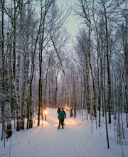 Lanterns line the Superior Loop in Porcupine Mountains Wilderness State Park during a lantern-lit hike and ski on Jan. 25, 2020. The park hosts the lantern event every Saturday in January and February.