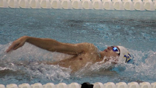 Mountain Home's Brandon Weaver competes in a backstroke event on Saturday at Fayetteville.