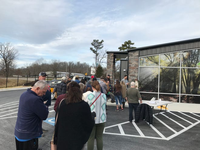 Patients line up waiting for Plant Family Therapeutics to open on Monday morning. The marijuana dispensary is now open to the public.