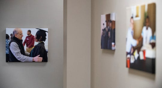 A photo of David Barranco congratulating graduates at a  Inspired Ministries graduation, hangs in the HIM offices in Montgomery, Ala., on Monday February 13, 2020.