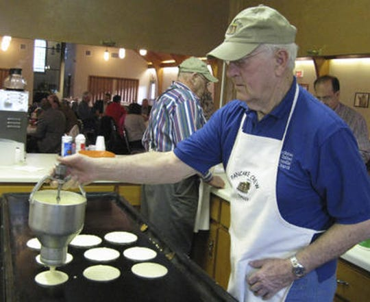 Tally Arnold drops batter onto a grill for a Pancake Crew fund-raising meal for the Blackman United Methodist Church Men's Club ministry on March 4, 2010.