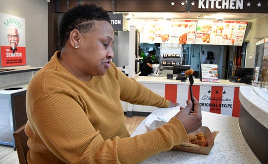 Brenda Fleming tries the new KFC's Beyond Fried Chicken at a store in Nashville on Feb. 3, 2020.