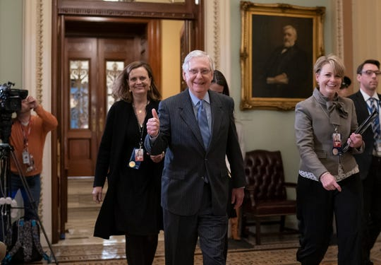 Senate Majority Leader Mitch McConnell, R-Ky., signals thumbs-up leaving the Senate chamber after during the impeachment trial of President Donald Trump on charges of abuse of power and obstruction of Congress, at the Capitol in Washington, Friday, Jan. 31, 2020. The Senate narrowly rejected Democratic demands to summon witnesses for President Donald Trump's impeachment trial late Friday, all but ensuring Trump's acquittal in just the third trial to threaten a president's removal in U.S. history. But senators moved to push off final voting on his fate to next Wednesday. (AP Photo/J. Scott Applewhite)