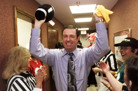 In 2002, Fort Myers attorney Jeff Rice walks through a crowd of employees during a surprise party at Goldstein, Buckley, Chechman, Rice & Purtz. Rice was the umpire in the Super Bowl in New Orleans that year when the Patriots beat the Rams.