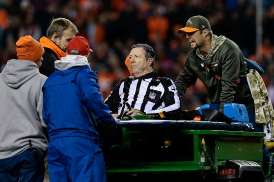 Nov 12, 2017; Denver, CO, USA; NFL official Jeff Rice (44) is carted off the field in the third quarter of the game between the Denver Broncos and the New England Patriots at Sports Authority Field. Mandatory Credit: Isaiah J. Downing-USA TODAY Sports