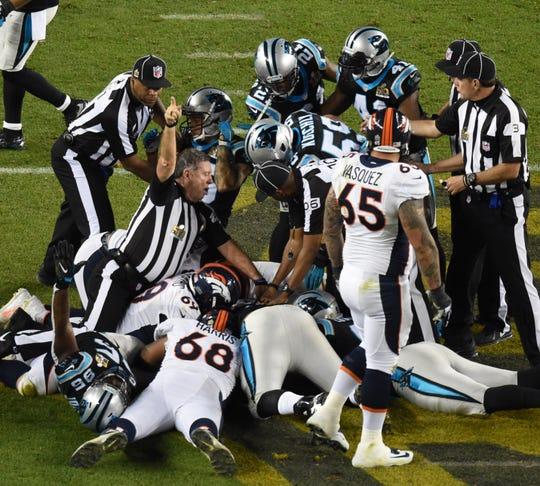 NFL umpire Jeff Rice (44) of Fort Myers signals a Carolina fumble recovery in Super Bowl 50 at Levi's Stadium in Santa Clara, Calif., on Feb. 7, 2016.