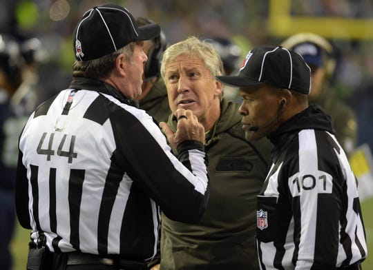 Seattle Seahawks head coach Pete Carroll argues with umpire Jeff Rice (44) of Fort Myers and line judge Carl Johnson (101) during a NFL football game against the Arizona Cardinals at CenturyLink Field in Seattle in 2015.