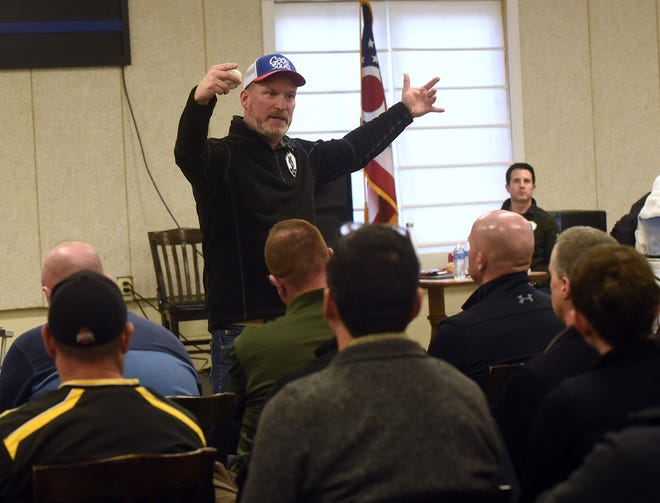 Jake Clark, president and founder of Save A Warrior, leads a group of nearly 150 first-responders from more than 20 departments in Ohio in a discussion of trauma and coping mechanisms during a free first-responder training on Monday Feb. 3, 2020 at the Fraternal Order of Police Lodge 127 in Newark. The session ended with training in SAW's own mindfulness-based meditation tactic, known as Warrior Meditation. Those interested in learning more about SAW should visit saveawarrior.org.
