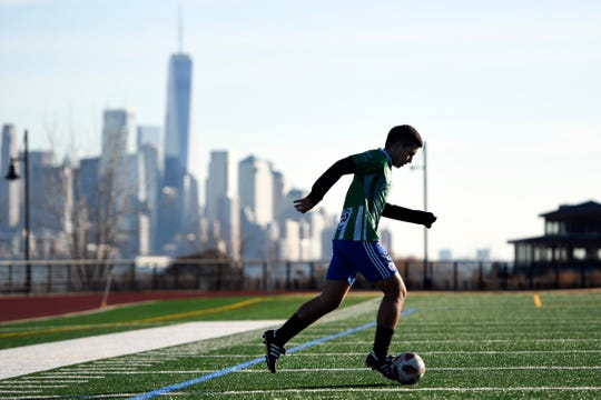 Andrew Carmona, 16 of North Bergen, works out in Weehawken during an unseasonably warm day on Monday, Feb. 3, 2020. Temperatures were in the high 50s in North Jersey.