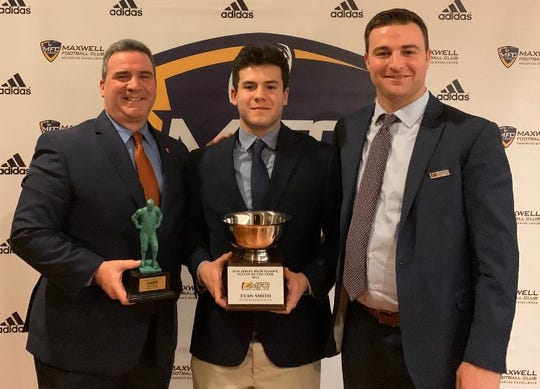 Butler senior quarterback Evan Smith, center, was recently named New Jersey Player of the Year by the Maxwell Football Club.