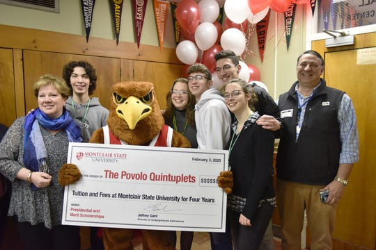 The Povolo family, with quintuplets in the senior class at Passaic Valley Regional High School, were given a surprise gift of a full-ride scholarship in Little Falls, N.J. on Monday Feb. 3, 2020. Montclair State University has offered the scholarship to the five high school seniors to attend the university.