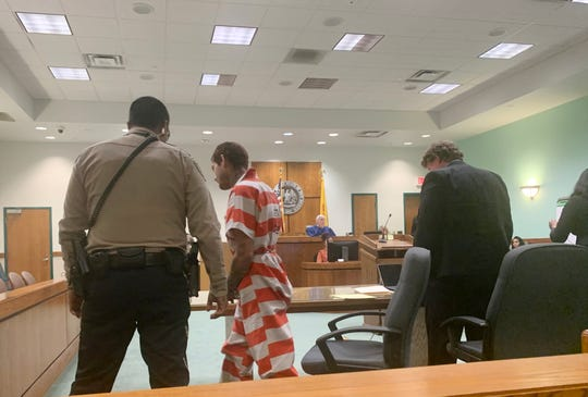Jay Andras, 23, exits Third District Court Judge Douglas Driggers' courtroom Monday, after a pre-detention hearing. Andras, who is charged with rape, kidnapping and armed robbery, was ordered held without bond.