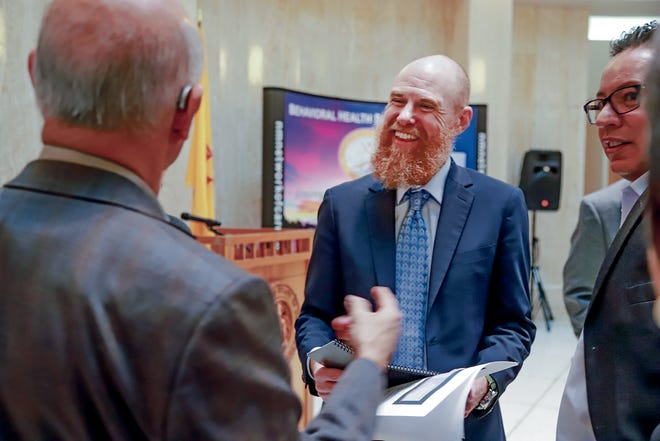 Brian Blalock, new secretary of the New Mexico Children, Youth and Families Department, speaks to people in the Rotunda after his Behavioral Health Day presentation this month at the Capitol.