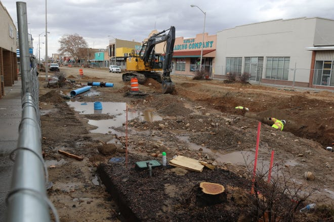 Puddles of water are pictured near a trench dug by workers from AUI Inc. on Feb. 3, 2020, on East Main Street in downtown Farmington. A corporation stop, or valve, was pulled out while workers were digging the trench, causing a leak, but a city spokeswoman said the damage was repaired in approximately an hour, and downtown business owners suffered no interruptions in service. The work is part of the Complete Streets project, which is providing a facelift for the district.