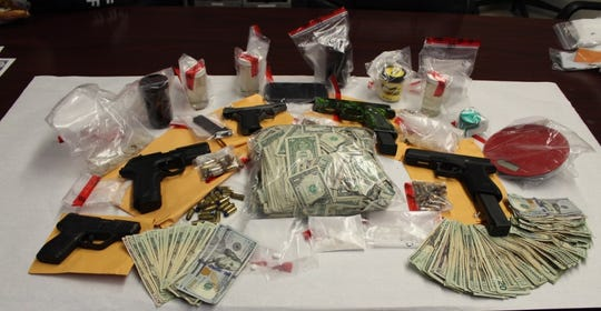 The Escambia County Sheriff's Office seizedfive guns, 870 grams of methamphetamine, 10 grams of marijuana, 15 grams of cocaine and $2,293 dollars in cash after executing a warrant Friday at a residence on North Y Street.