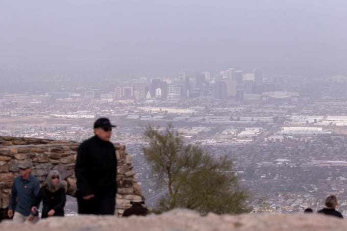Downtown Phoenix, obscured by haze, is seen on Monday, Feb. 3, 2020, from Dobbins Lookout at South Mountain in Phoenix.