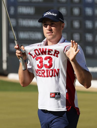 February 2, 2020; Scottsdale, AZ, USA; Justin Thomas reacts after making a birdie putt wearing Kobe Bryant's high school jersey on the 16th hole during final round action on Feb. 2 during the Waste Management Phoenix Open at the TPC Scottsdale Stadium Course. Mandatory Credit: Rob Schumacher/The Republic via USA TODAY NETWORK