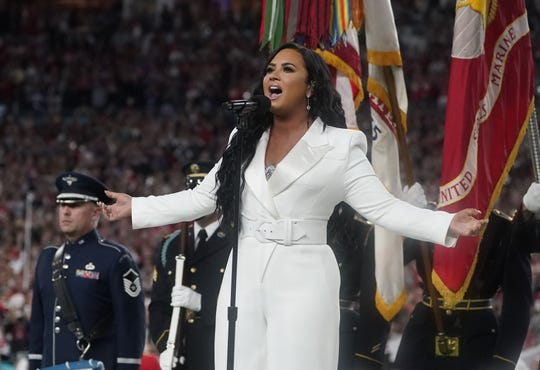 US singer Demi Lovato sings the National Anthem ahead of Super Bowl LIV between the Kansas City Chiefs and the San Francisco 49ers at Hard Rock Stadium in Miami Gardens, Florida, on February 2, 2020.