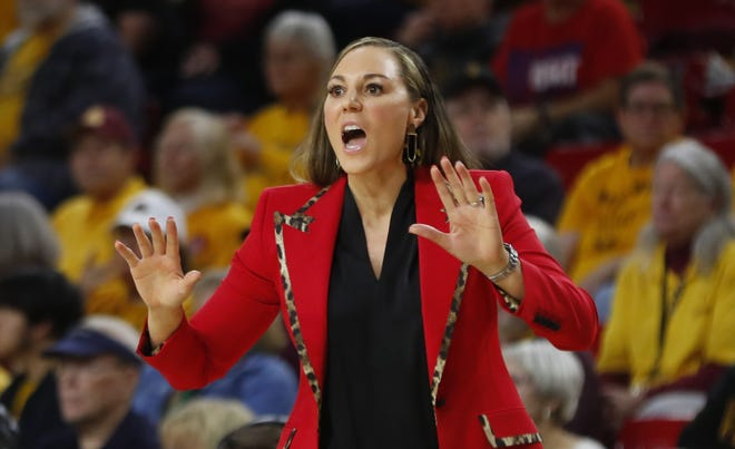 Arizona's head coach Adia Barnes yells to her team during the first half at Desert Financial Arena in Tempe, Ariz. on Dec. 29, 2019.
